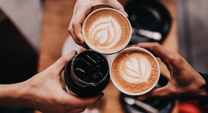 People holding coffee cups together