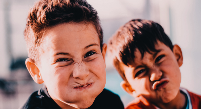 Two children making funny faces
