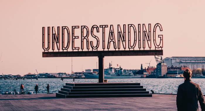 """Large sign that says """"understanding"""""""