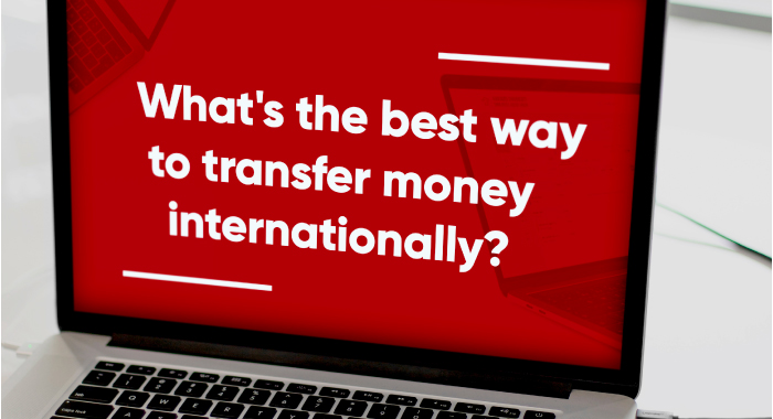 """Computer displaying the question, """"What's the best way to transfer money internationally?"""""""
