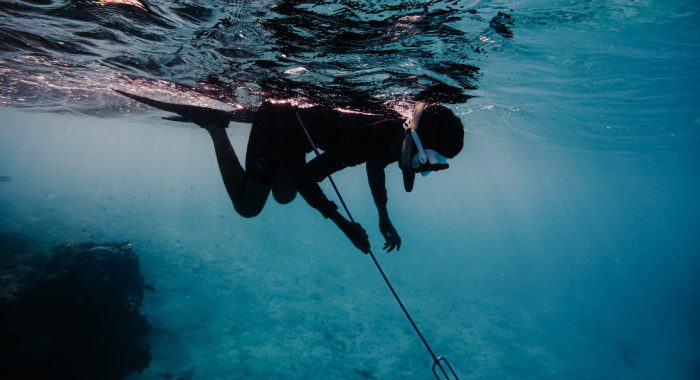 person spear fishing