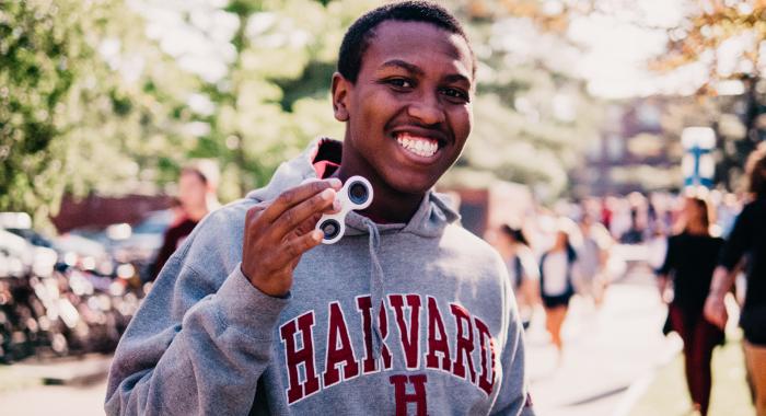Person smiling at the camera and wearing a Harvard sweatshirt
