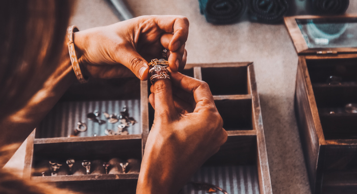 Person looking at rings in a jewelry box
