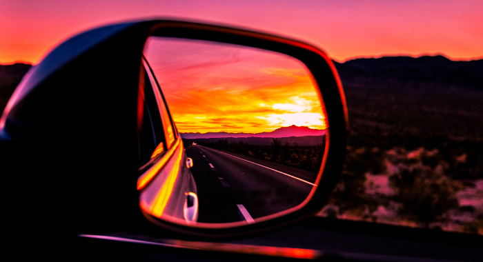 sunset in car side mirror