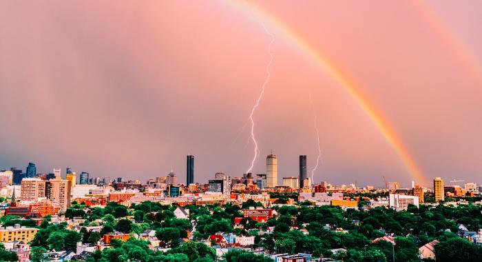 rainbow and lightning over Boston skyline