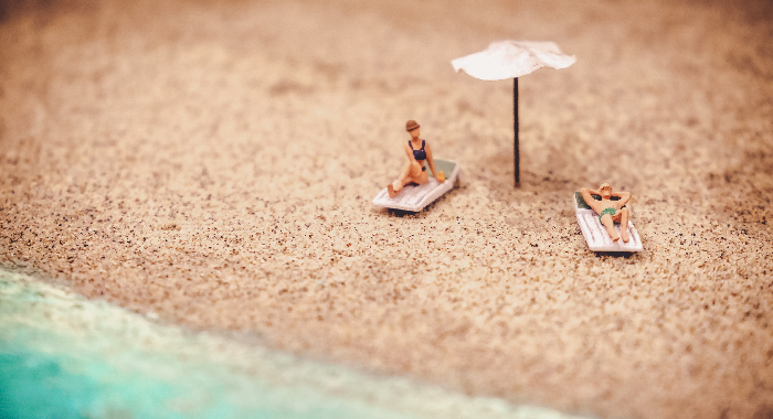 Toy figurines on a beach setting