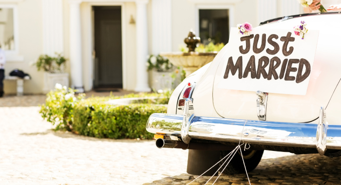car with a sign that reads Just Married