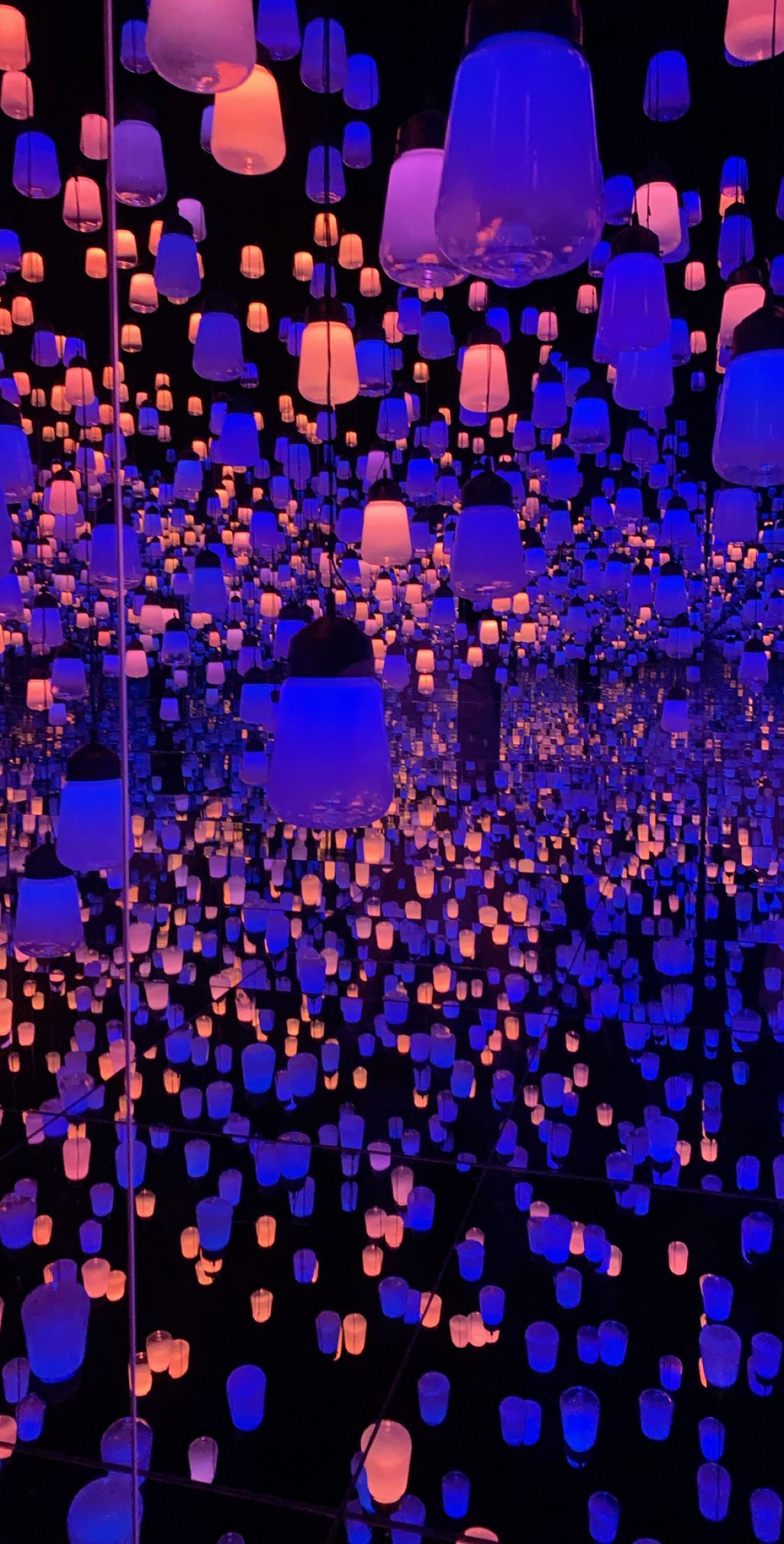 The EPSON TeamLab Borderless exhibit in Tokyo displaying hanging lamps