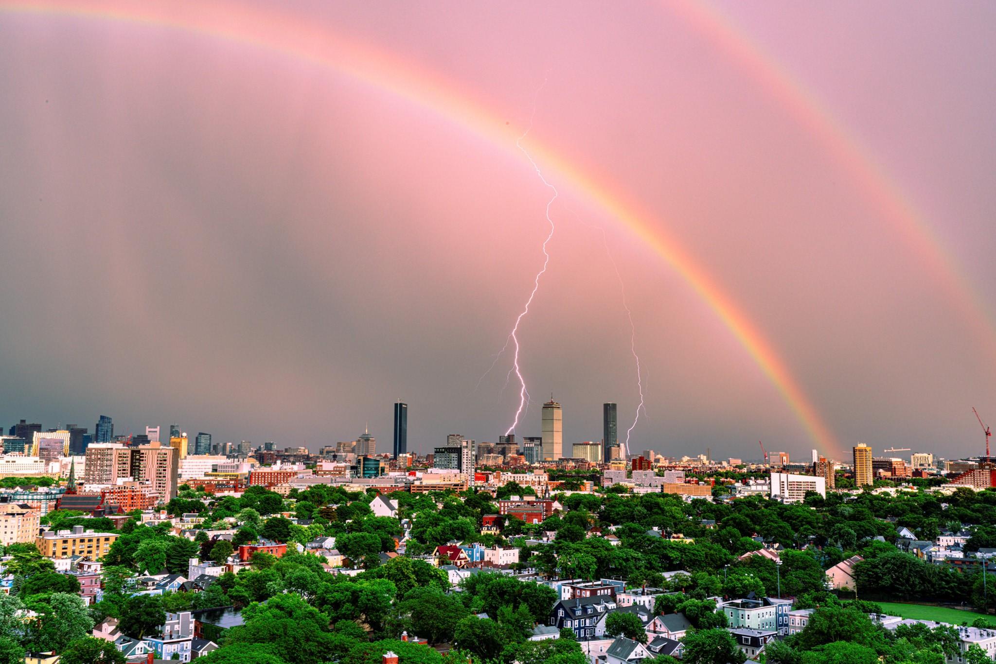 double rainbow and lightning over Boston skyline
