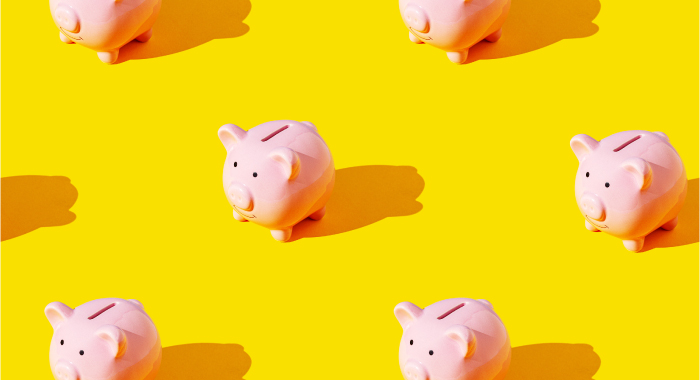 Piggy banks on a yellow background
