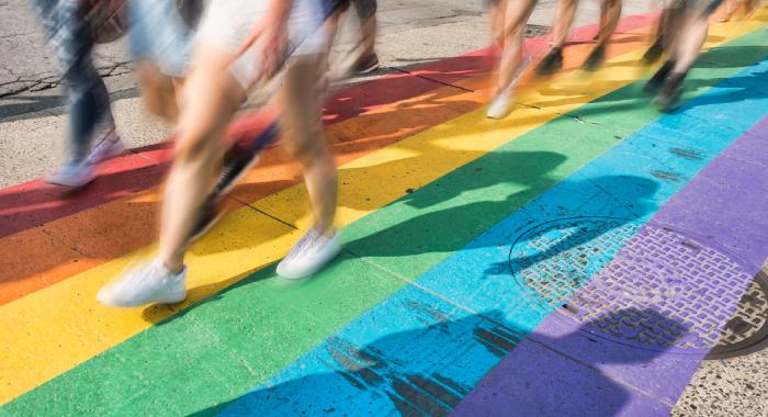 People walking on a rainbow