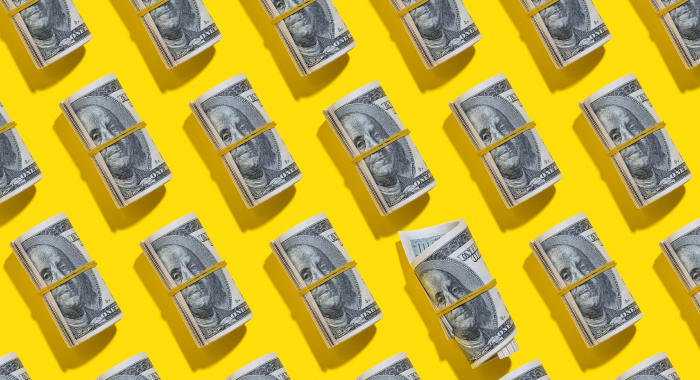 Dollar bill rolls on a yellow background