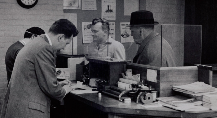 Tellers at the bank, black and white picture