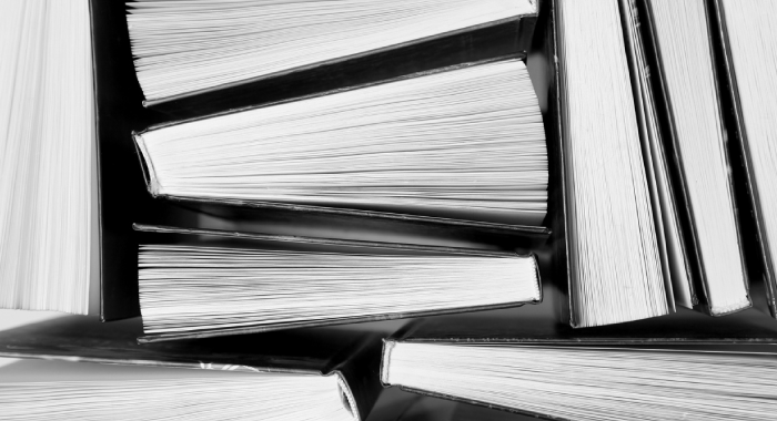 Pile of books, black and white photo